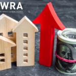 Imagem de casas com dinheiro e uma seta para cima